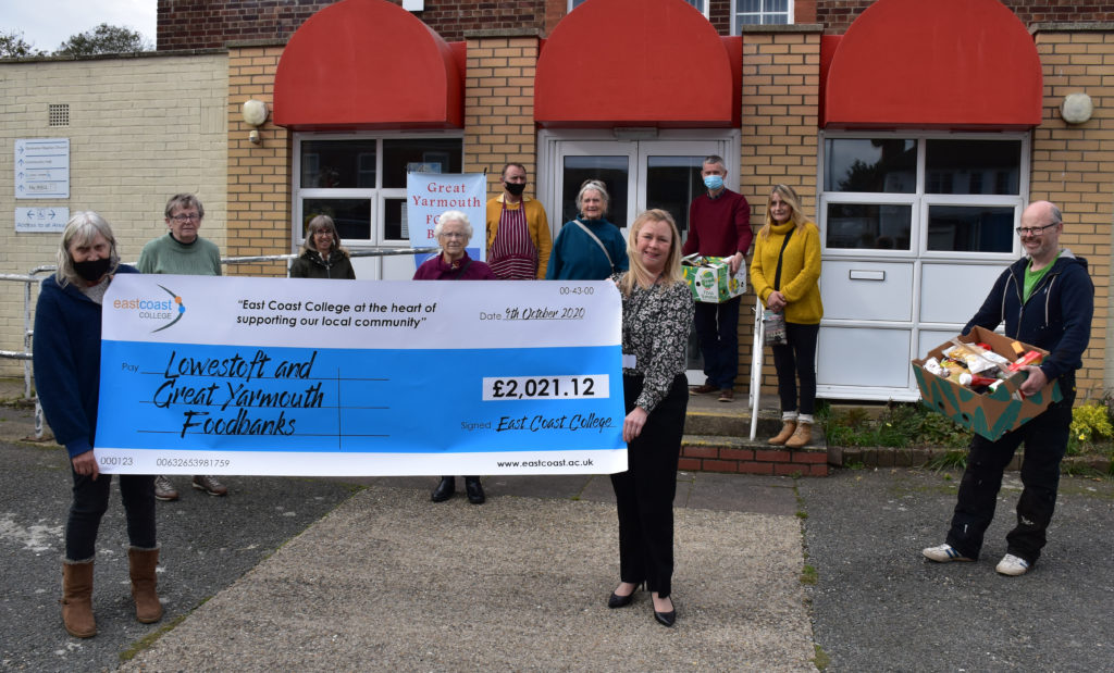 Liz Townson from Great Yarmouth Foodbank being presented with the cheque by East Coast College Assistant Principal Holly Chase,  along with foodbank volunteers.
