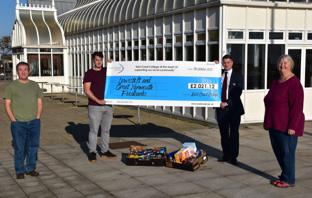 Sam Porter from Lowestoft Foodbank being presented with the cheque by East Coast College CEO Stuart Rimmer, along with foodbank volunteers.