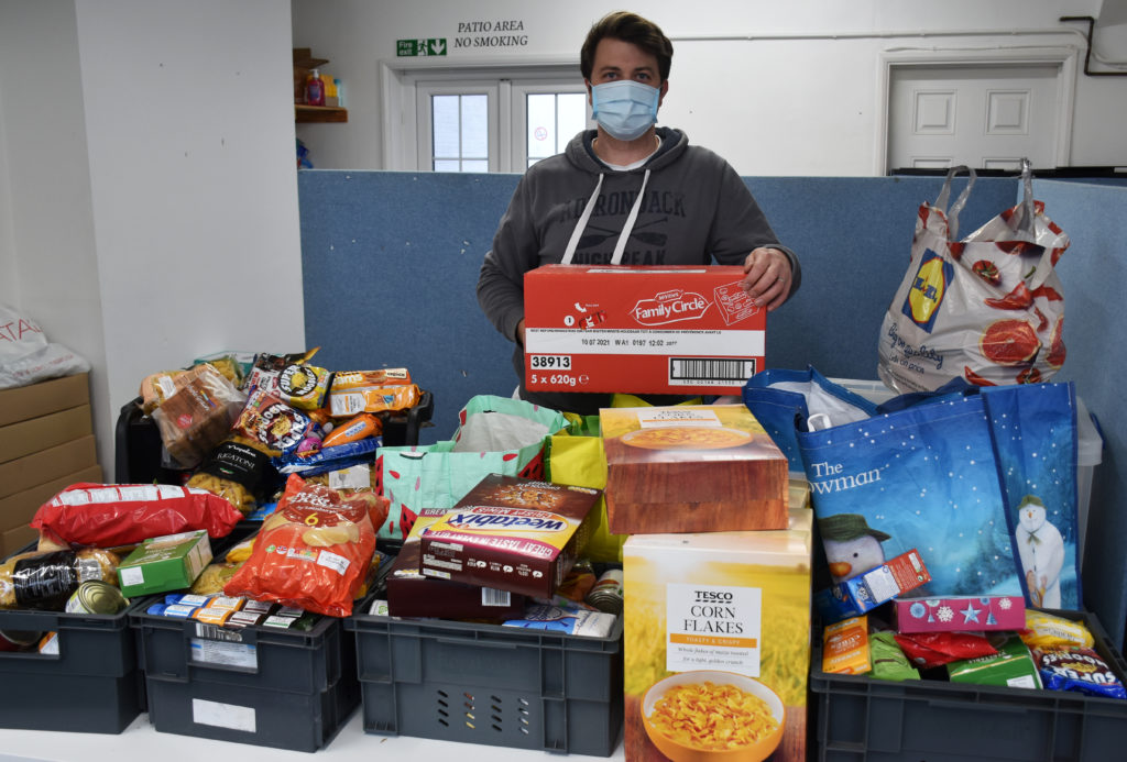 Sam Porter, Operations Manager for Lowestoft Foodbank, with the donation. Photo East Coast College.