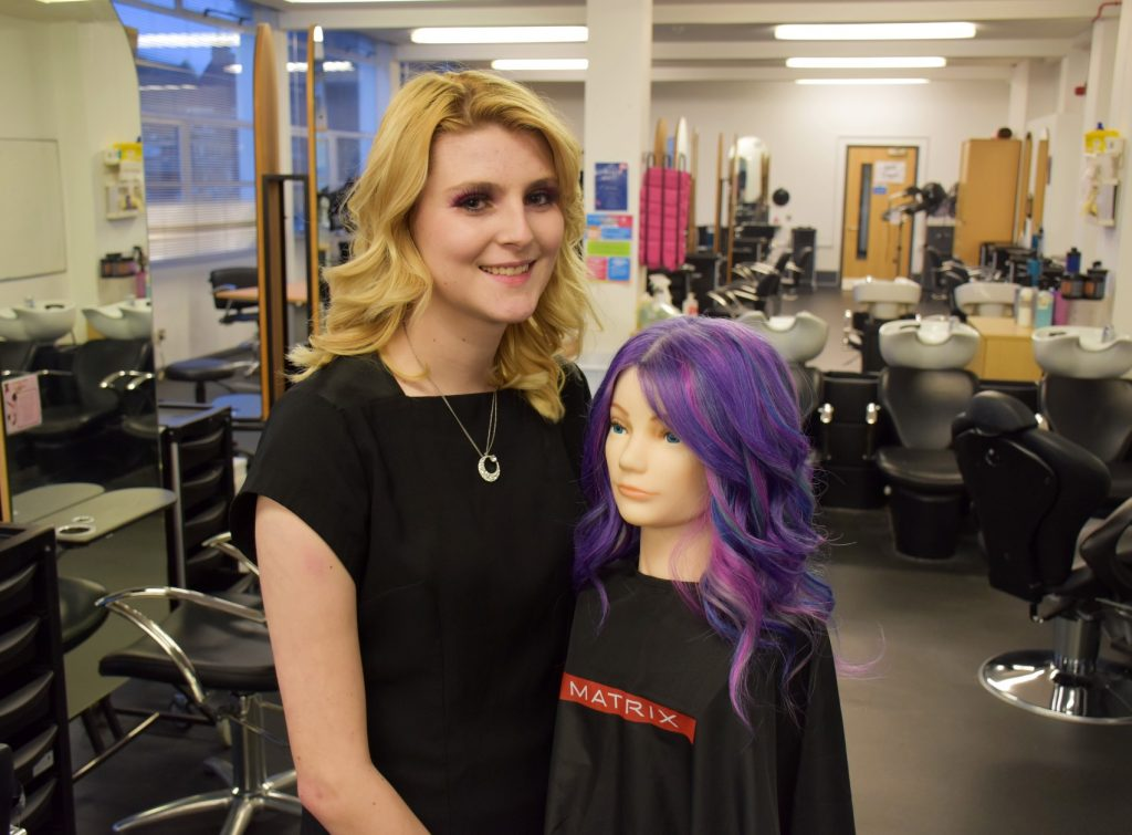 Chloe Brown with her finalist hair colour entry at the college salon. Photo East Coast College.